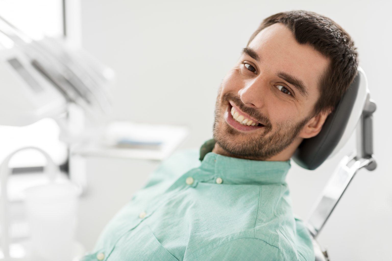 Happy Smiling Male Patient At Dental Clinic