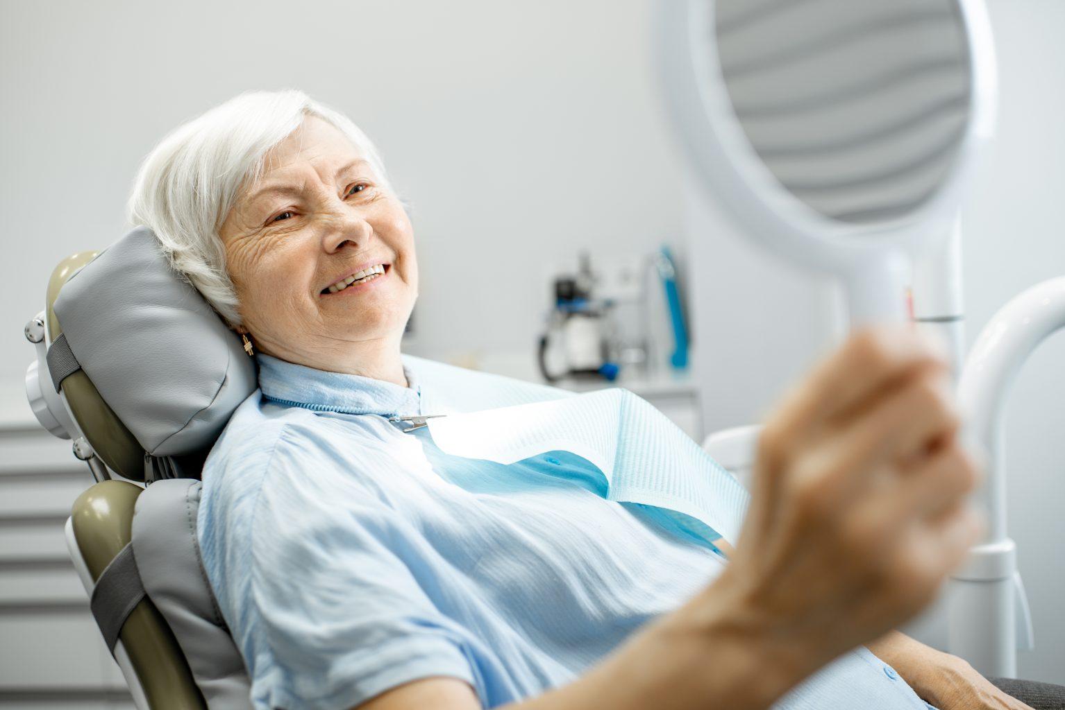Elderly Woman Enjoying Her Smile In The Dental Office