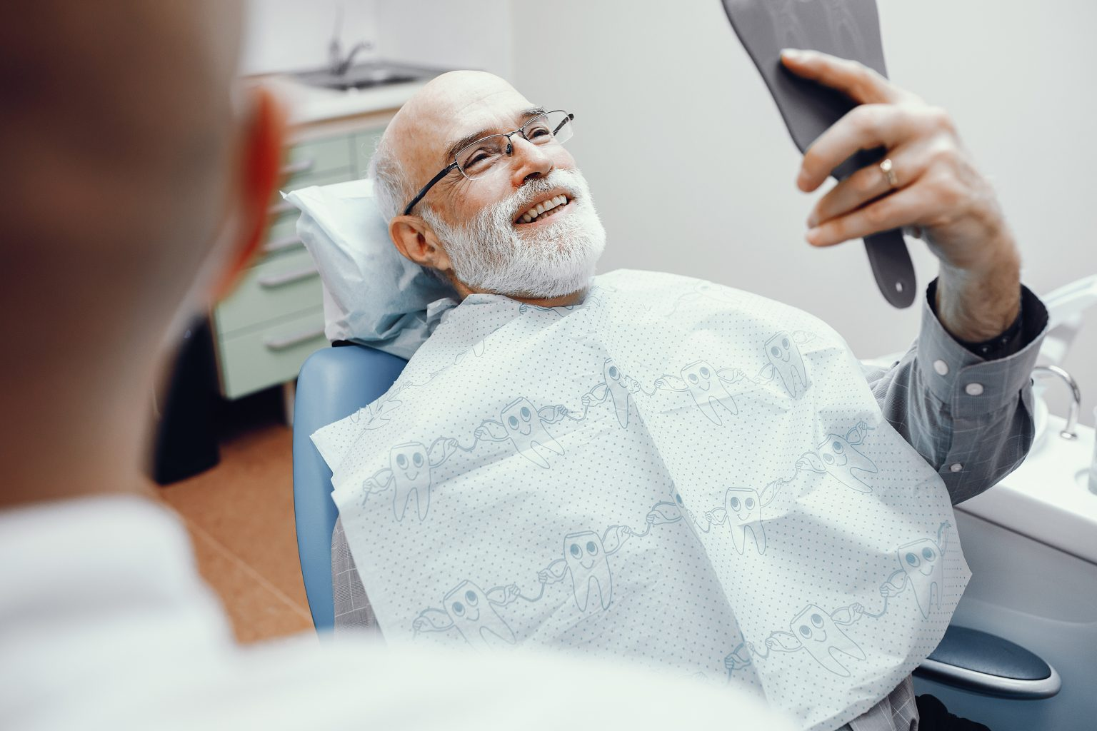 Old Man Sitting In The Dentist's Office